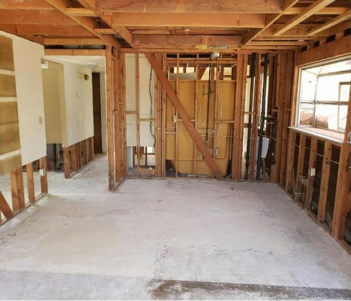 a open room with no drywall showing the framing of the kitchen.