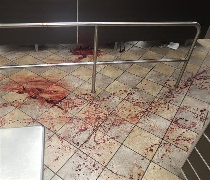 Restaurant tile floor is covered with splattered blood.